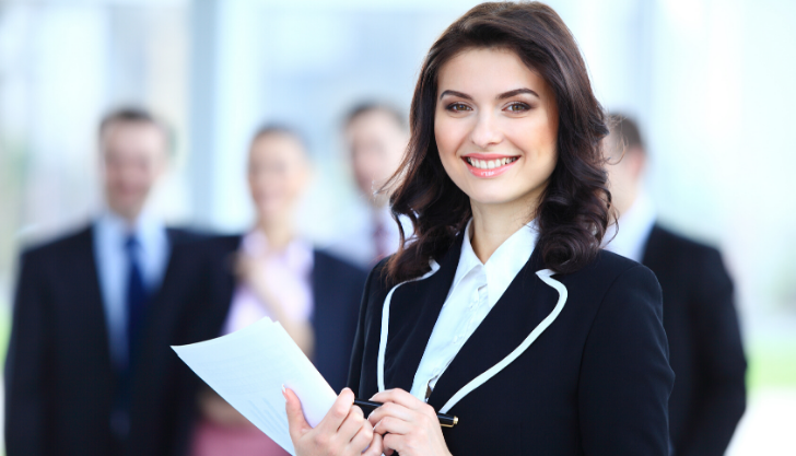 Woman smiling in suit representing a good company culture