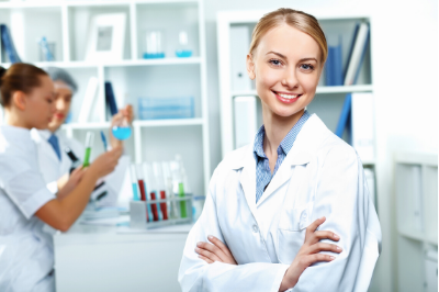 Woman in a lab coat representing SRO's pharmaceutical recruitment platform capabilities