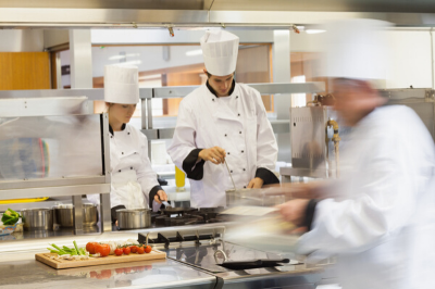 View of a chef in a kitchen cooking representing SRO's hospitality recruitment platform
