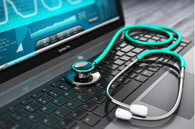 A stethoscope on a laptop representing medical & healthcare recruitment