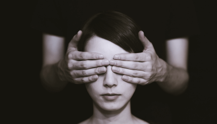 Blind CVs represented by woman with eyes being covered