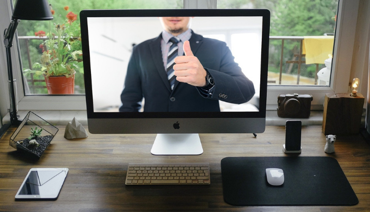 man on a video call representing motivating staff remotely
