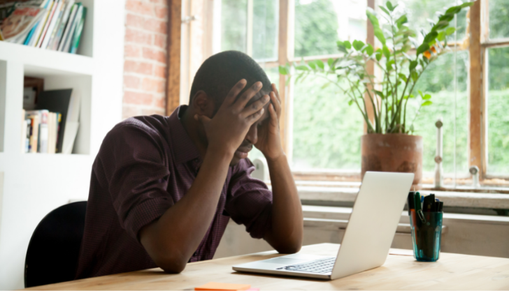 man frustrated at desk due to candidate shortages
