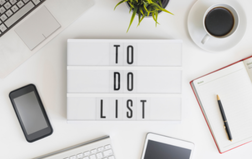 The words 'to do list' on a desk