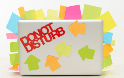 A laptop with the words 'do not disturb' on it
