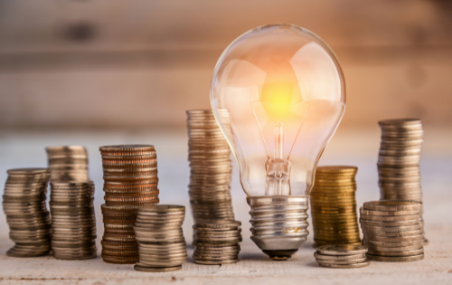 View of a lightbulb amongst money coins