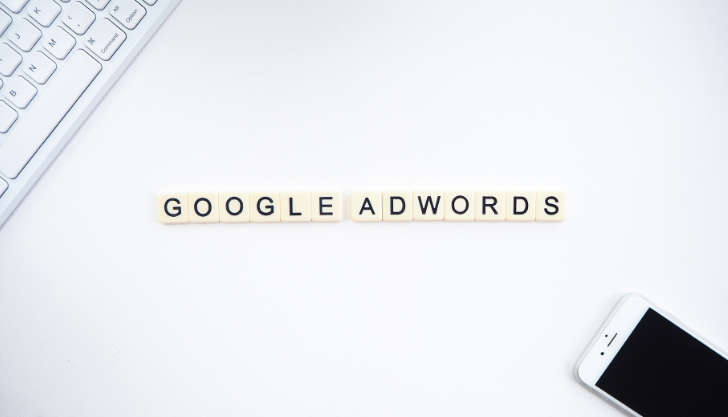 Google Adwords written on a desk representing google ads for recruiting