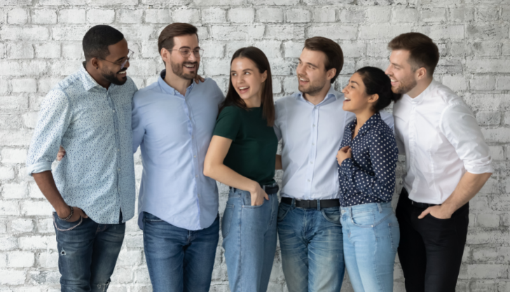 group of six employees together showing why diversity hiring is important