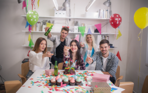 group of co-workers celebrating with cake to build teamwork culture