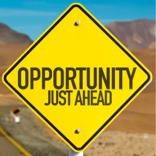 A sign saying 'opportunity just ahead'
