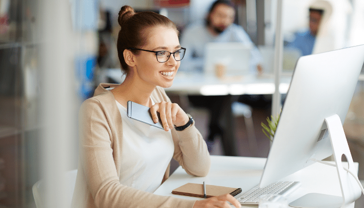 Woman sat at laptop representing how to reduce recruitment costs